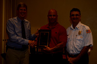 City Manager Jim Scholl, Fire Fighter of the Year Benny Lowe, Division Chief Michael Davila,