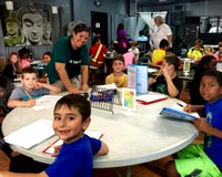 President and CEO, Kate Bauer-Jones, assists students with math and writing homework at Marathon Recreation Center. The Rec Center provides after school academic assistance to elementary, middle, and