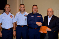 Coast Guard Sector Key West Commander Capt. Jeff Janszen, Command Master Chief Jeff Egelston, Eric Kenerly & Phil Goodman. Eric Kenerly, received from Phil Goodman his volunteer service award.