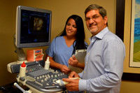 Dr Peterson and his medical assistant Claudia Valdes viewing 3D/4D ultrasound.