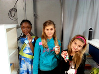 More students show off their great work crafting holiday ornaments.